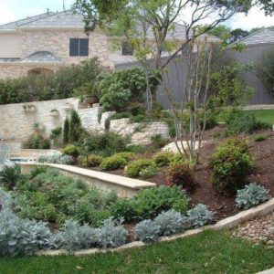 Landscape w/ Retaining Walls, Bushes & Misc. Plants