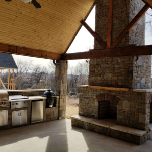 Patio Area w/ Outdoor Fireplace & Kitchen